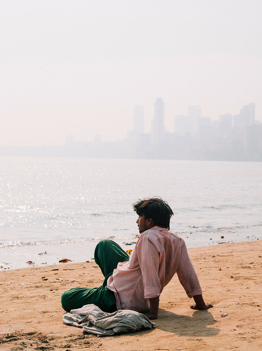 Man on the beach in Mumbai